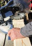 Circular Saw Cutting a Wood Plank Stock Photography