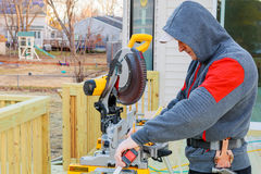 Circular saw cutting wooden plank. Blade with board close-up. Woodworking detail with wood. Working equipment carpentry workshop Stock Photos