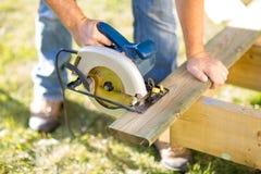 Circular Saw. Detail of circular saw cutting piece of wood stock photography