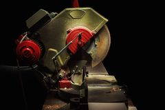 Circular Saw Details. Used circular saw on black background, closeup of details Royalty Free Stock Photography