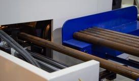 Circular saw machine cutting steel rod stock photo
