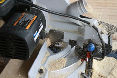 Circular saw in motion. Circular saw in action spewing sawdust Royalty Free Stock Photo