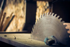 Circular saw. Old circular saw with wood as a background Royalty Free Stock Photos