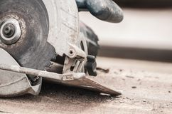 Circular saw over a pile of wooden planks. Tool used to saw wood. Carpentry tool. Electric saw stock images