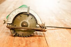 Circular saw or power saw on wooden background tool woodcraft object isolated royalty free stock image