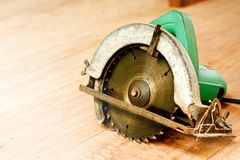 Circular saw or power saw on wooden background tool woodcraft object isolated stock image