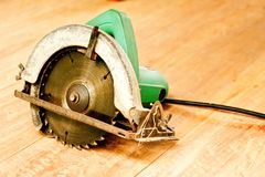 Circular saw or power saw on wooden background tool woodcraft object isolated royalty free stock photo