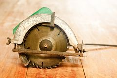 Circular saw or power saw on wooden background tool woodcraft object isolated stock photos