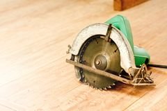 Circular saw or power saw on wooden background tool woodcraft object isolated royalty free stock images