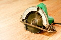 Circular saw or power saw on wooden background tool woodcraft object isolated stock photo