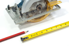 Circular saw and ruler Royalty Free Stock Photo