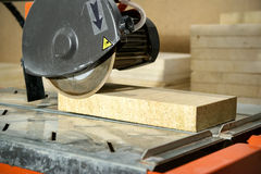 Circular saw with sawed-off tile Stock Photography