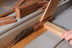 Circular saw sawing wood brick Stock Image