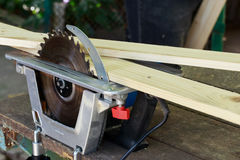 The circular saw. Set on a wooden table Stock Images
