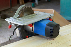 The circular saw. Set on a wooden table Royalty Free Stock Image