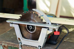 The circular saw. Set on a wooden table Royalty Free Stock Images