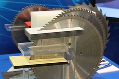 Circular Saw. Several saws for cutting solid wood. The saw on a tree equipped with plates from a firm alloy and diamond. Sawmill, logging, woodworking royalty free stock photography