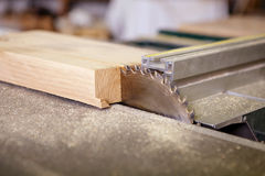 Circular saw sliced ​​into a piece of wood. Interior joinery stock photography