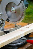 Circular saw and wood plank Stock Photo