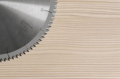 Circular Saw and the wood. Sharp circular saw on wood background bleached pine Royalty Free Stock Photos