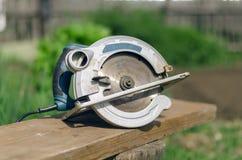 Circular saw. Circular saw and wooden beam Stock Photos
