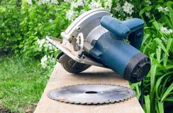 Circular saw. Circular saw and wooden beam Stock Image