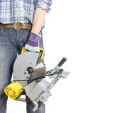 Circular saws. In a hand of the builder a �ircular saws. The isolated white background Stock Photography