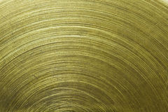 Circular scratch on gold metal Stock Photography