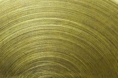 Circular scratch on gold metal. Macro of Circular scratch on gold brass metal Stock Photography