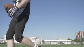 Circular shooting in motion around a player in a football uniform. 4K stock footage