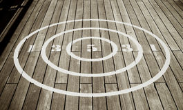 Circular Shuffle Board Target. An image of a circular shuffle board target on a wooden deck Royalty Free Stock Photos