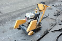 Circular small drill breaking street asphalt, Jackhammer breaking street asphalt, repairing damaged water supply Stock Images
