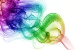 Circular Smoke. Circular rainbow colored smoke rising from burning incense Royalty Free Stock Photos