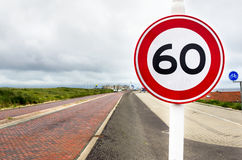 Circular Speed Limit Sign on a Brick Road Stock Photo