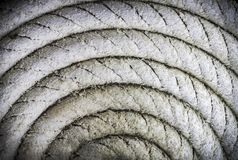 Circular spirally of old nautical rope. Background Royalty Free Stock Photo