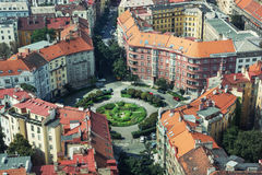 Circular square with old houses and beautiful lawn. In Prague, Czech republic Royalty Free Stock Images
