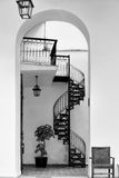 Circular staircase. Circular metal staircase through arched doorway Royalty Free Stock Images