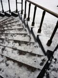Circular staircase in the snow. Winter, outdoor architecture details, Historical building stock photo
