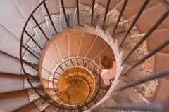 Circular staircase in Tivoli, Italy. A woman descend a staircase in Villa d'este, Tivoli, Italy Stock Image
