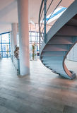 Circular stairs in modern office Stock Photos