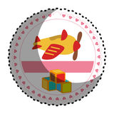 Circular sticker with airplane and cubes toys Stock Photo