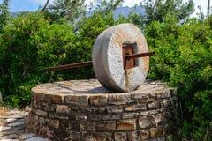 Circular stone for grinding grain Royalty Free Stock Photo