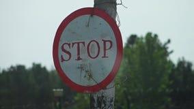 Circular Stop Sign. Steady, close up, exterior shot of a circular stop sign stock video footage
