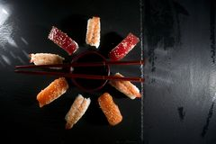 Circular sushi plate with chopsticks Royalty Free Stock Photos