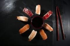 Circular sushi plate with chopsticks Stock Photos