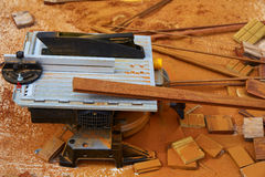 Circular table saw carpenter tool and sawdust Royalty Free Stock Photo