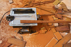 Circular table saw carpenter tool and sawdust Royalty Free Stock Photos