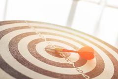 Circular target arrow marked with dart with defocused