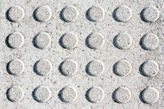 Circular textures on granite floor Stock Images
