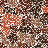 Circular, tribal pattern in brown tones with motifs of an African tribes Surma and Mursi Stock Images